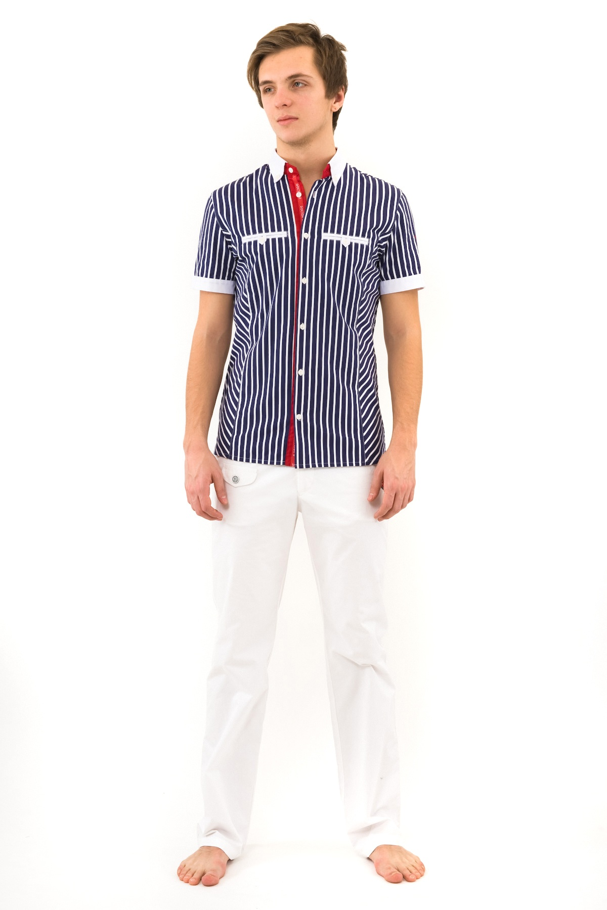 РубашкаМужские рубашки<br>Сорочка мужская с оригинальной вышивкой на левом рукаве, с функциональными нагрудными прорезными карманами.<br><br>Цвет: синий<br>Состав: 100% хлопок<br>Размер: 44<br>Страна дизайна: Россия<br>Страна производства: Россия