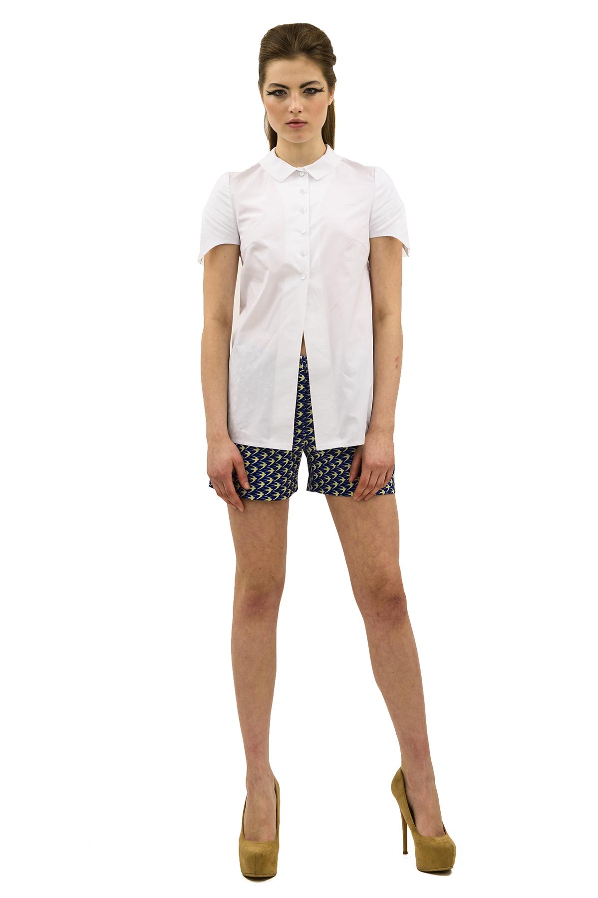 БлузаЖенские блузки<br>Привлекательная блузка лаконичного дизайна. Модель с оригинальными рукавами выполнена из ткани актуального цвета. Эта вещь станет прекрасной составляющей Вашего повседневного гардероба.<br><br>Цвет: белый<br>Состав: 100 % хлопок<br>Размер: 40,42,44,46,48,50,52,54,56,58,60<br>Страна дизайна: Россия<br>Страна производства: Россия
