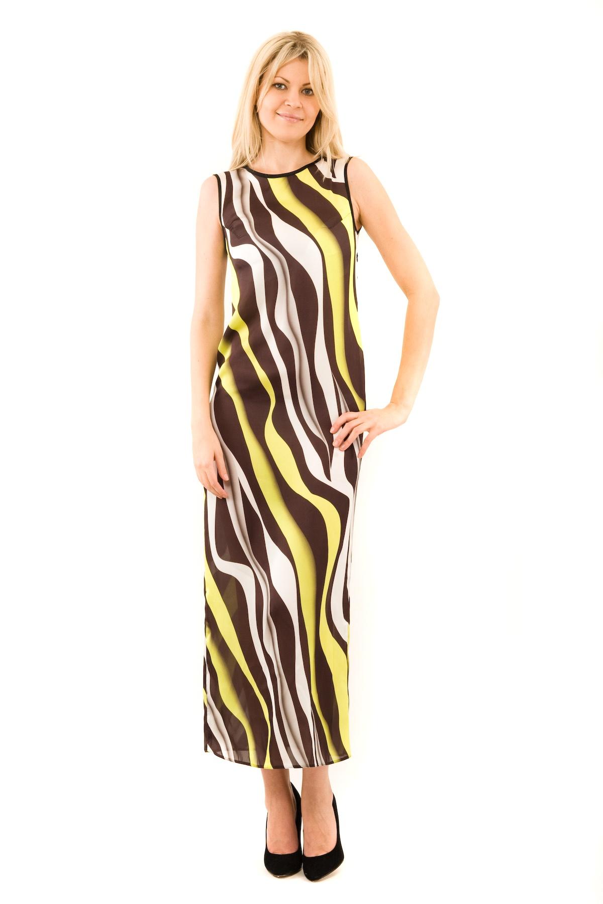 ПлатьеПлатья,  сарафаны<br>Великолепное платье-макси с дизайнерским принтом выполнено в стиле color blocking. Модель с округлым вырезом горловины. Спинка, лиф и рукава выполнены из прозрачного материала. От этого платья просто невозможно отвести глаз. Позвольте себе быть единственн<br><br>Цвет: черный,белый,желтый<br>Состав: 100 % полиэстер<br>Размер: 42,44,46<br>Страна дизайна: Россия<br>Страна производства: Россия