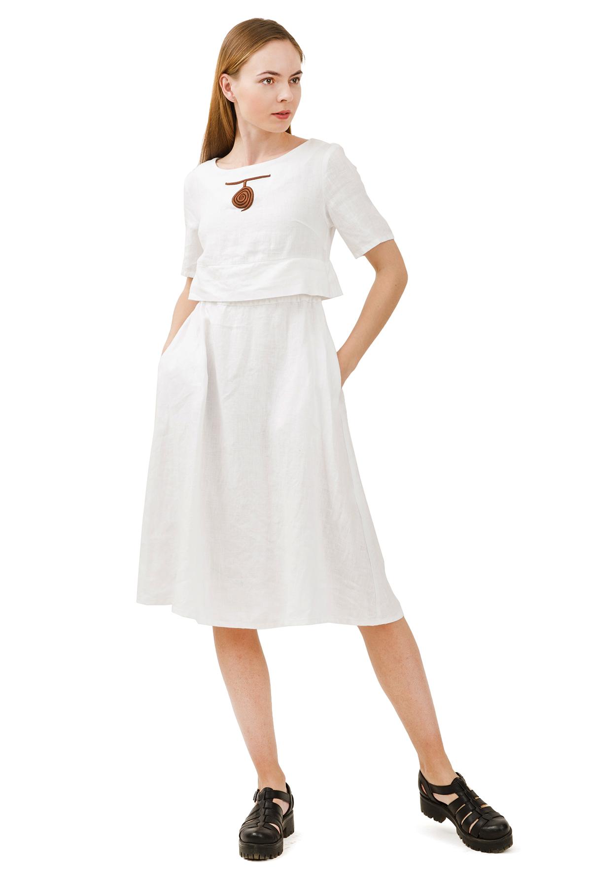 ПлатьеПлатья,  сарафаны<br>Стильное платье выполнено из натуральной ткани - льна. Данная модель удачно подчеркнет красоту Вашей фигуры, а яркая расцветка  не оставит Вас незамеченной.<br><br>Цвет: белый<br>Состав: 100% лен<br>Размер: 40,42,44,46,48,50,52,54<br>Страна дизайна: Россия<br>Страна производства: Россия