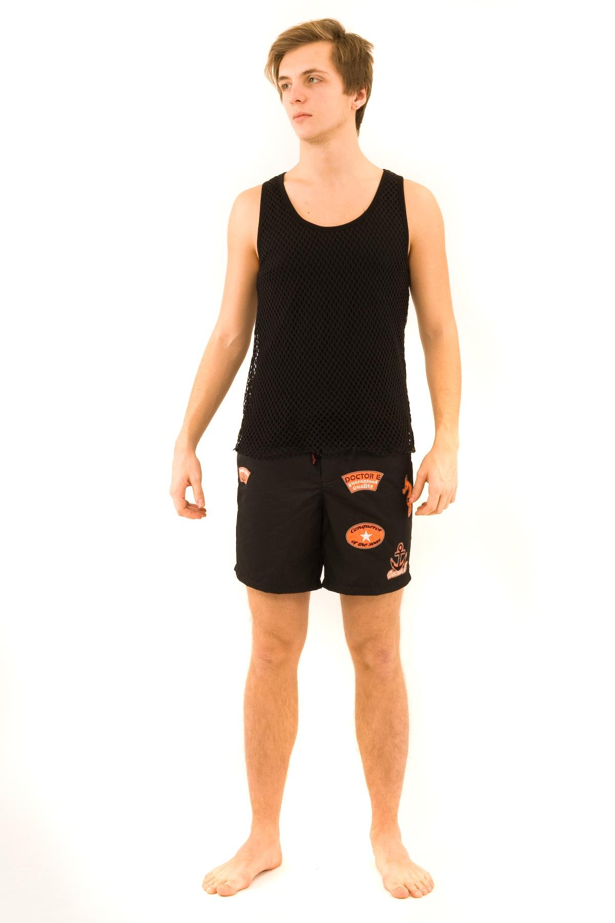 МайкаМужские футболки, джемпера<br>Стильная, двухслойная майка Doctor E с округлым вырезом горловины. Верх изделия выполнен из сетки, под ним — приятная и комфортная трикотажная ткань. Прекрасная базовая вещь для модного летнего гардероба.<br><br>Цвет: черный<br>Состав: ткань 1 - 92% вискоза, 8% лайкра, ткань 2 - 100% полиэстер<br>Размер: 44,46,48,50,52,54,56,58,60<br>Страна дизайна: Россия<br>Страна производства: Россия